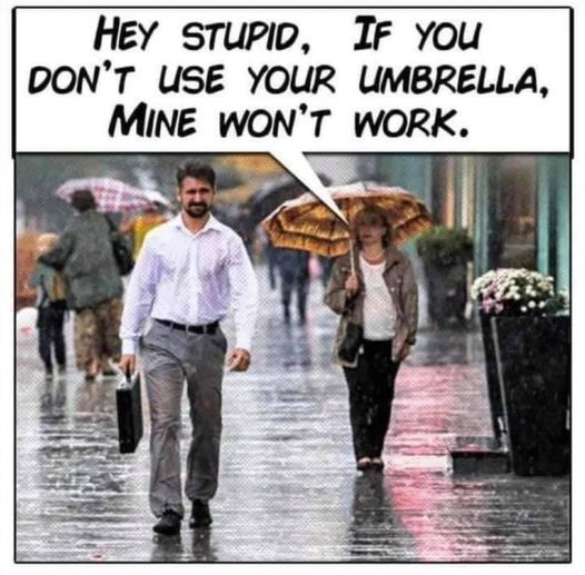 Man not using an umbrella in the rain