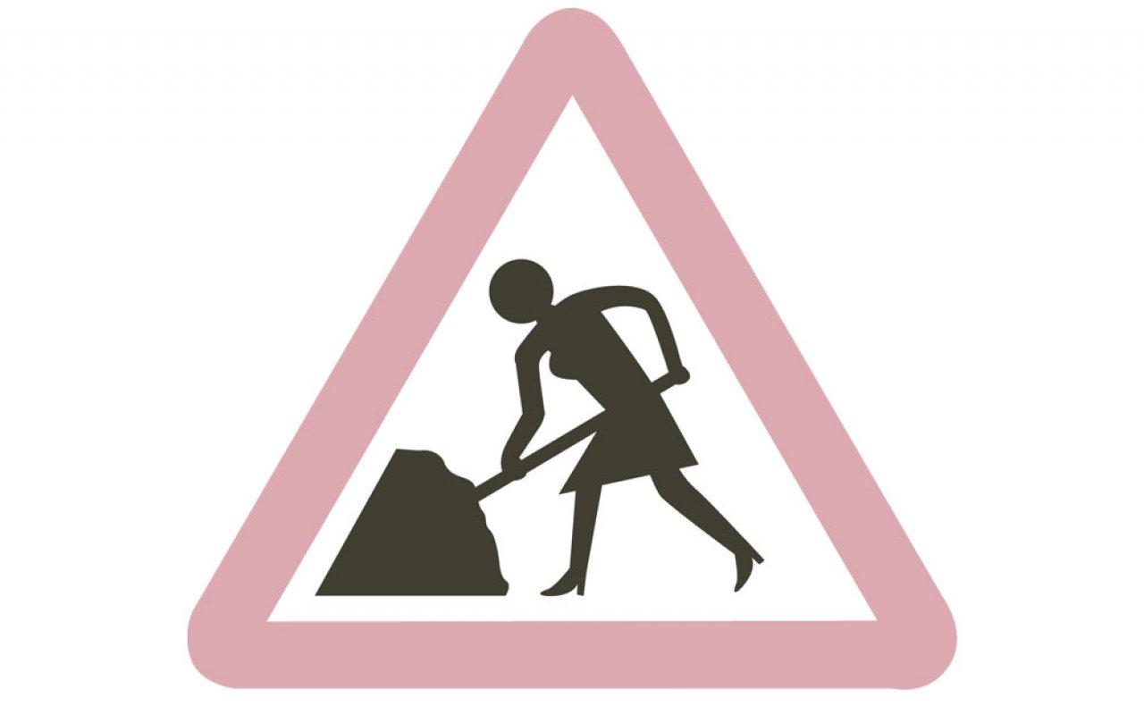Women at work roadworks sign