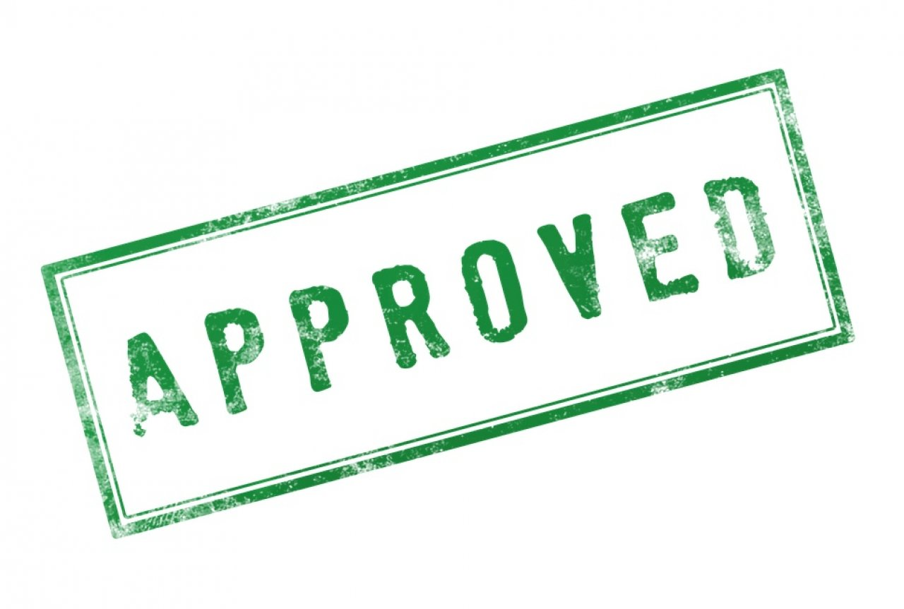 Rubber stamp saying 'Approved'