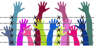 Human rights hands in the air behind barbed wire