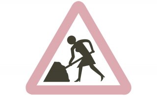 Women at work roadworks sign