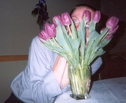 Stef behind flowers