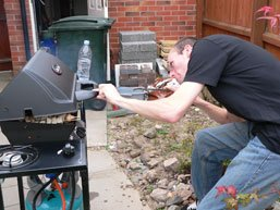 Stef tends to the barbecue like a man