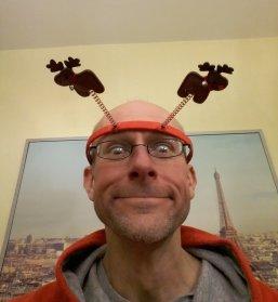 Stef wearing reindeer Deely Boppers