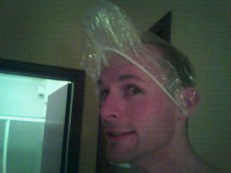 Stef models the latest in plastic hotel beaker and shower cap attire
